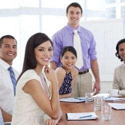 group of hispanic entrepreneurs seated at a conference table