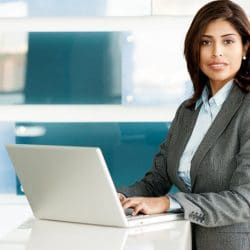 latina business woman seated at conference table