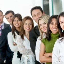 group of Hispanic professionals lined up outside building