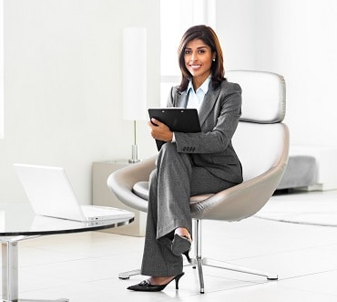Young Hispanic Businesswoman sitting in a office chairin Office