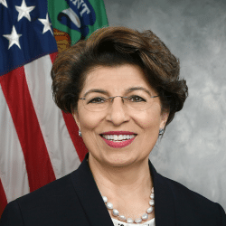 Jovita Carranza headshot with American Flag in the background