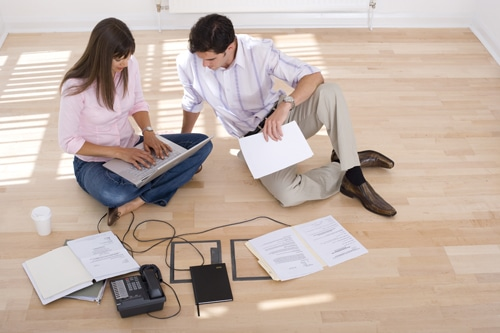 Young Hispanic couple, woman with laptop computer