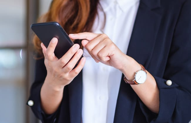 Close up of woman using mobile phone