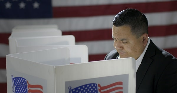 A latino man at a polling place