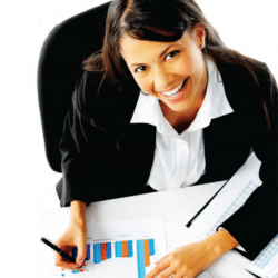 Latina businesswoman looking up from her desk filled with paperwork smiling