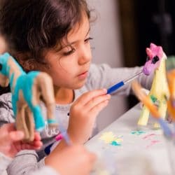 Two children painting ceramic art