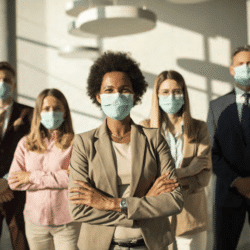 Diverse group of professionals, wearing masks,