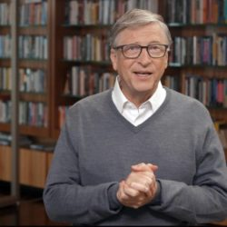 Bill Gates in a gray sweater library background