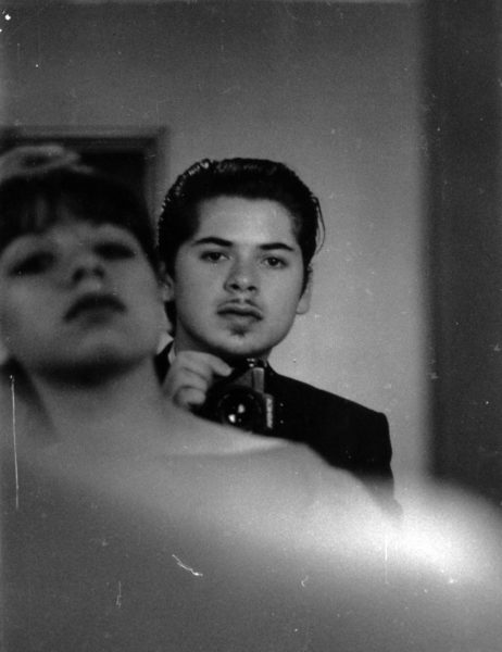 black and white image of a man and a woman himself in a mirror