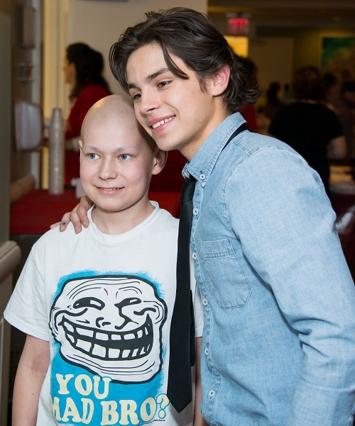 Ambassador Jake T. Austin poses with a patient at the Ronald McDonald House