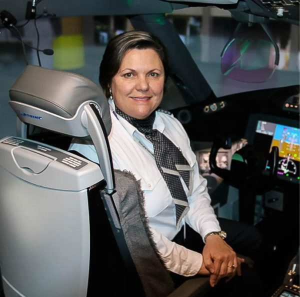 Linda Pauwels sitting in the pilots quarters of a plane