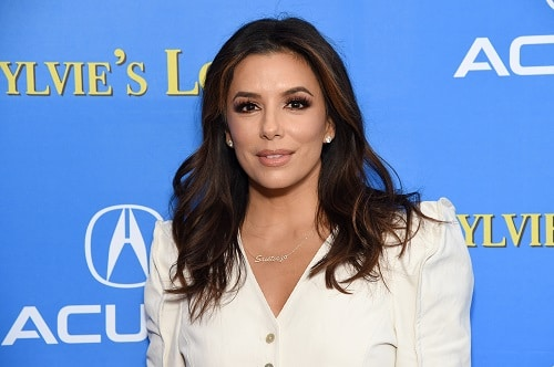 Eva Longoria at a red carpet event, posing for the camera