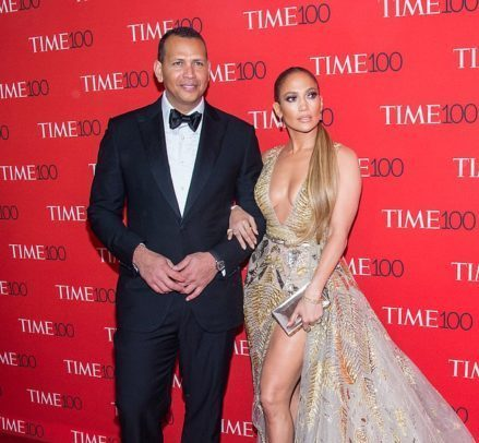 Jennifer Lopez and Alex Rodriguez posing for the camera at a red carpet event
