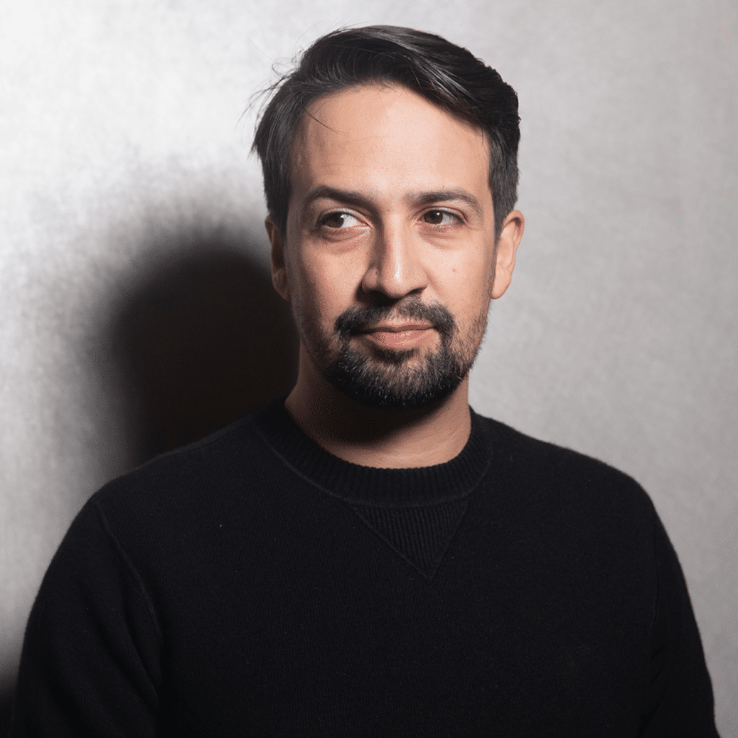 Vivo star Lin Manuel photographed wearing a black long sleeve t shirt in front of a gray background