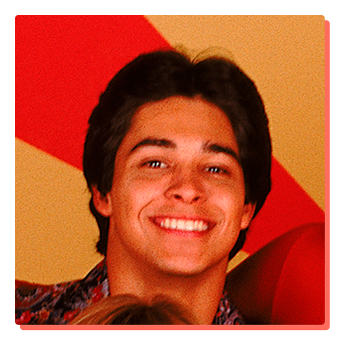 Wilmer Valderrama head shot in front of a red and yellow background from that's 70s show