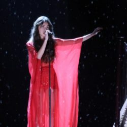 """Olivia Rodrigo performing at the Brit Awards this month. The 18-year-old pop singer's debut album, """"Sour,"""" opened at the top of the Billboard 200 chart"""