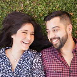 Hispanic couple met on dating site and are laying in the grass