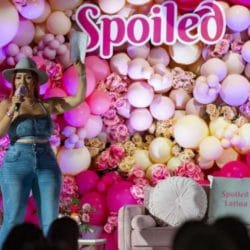 """Raquel Cordova speaks during the sixth annual """"Spoiled Latina Day"""" on Saturday, July 31, 2021, at Madera Estates in Conroe. Spoiled Latina, a digital platform that describes itself as """"celebrating what it means"""