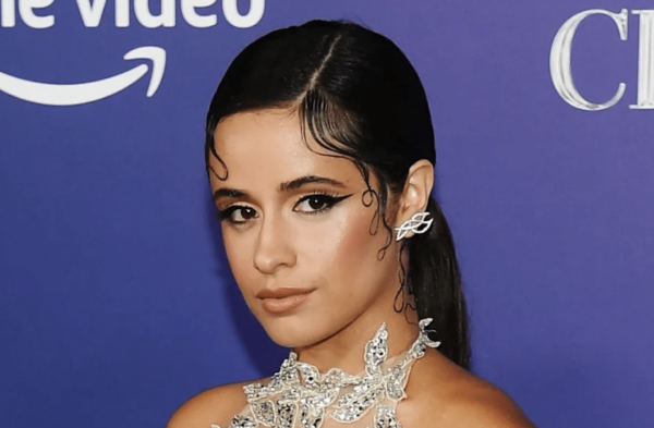 Camila Cabello at a red carpet event looking at the camera