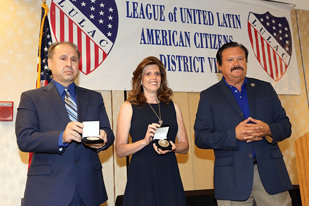 Parents of Brandon Caserta accept award onstage with LULAC representative