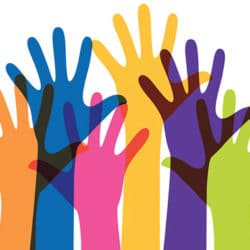 Hispanic Heritage Month: Professor's multicultural upbringing nurtures passion for language education. Photo of rainbow colored hands reaching for the air